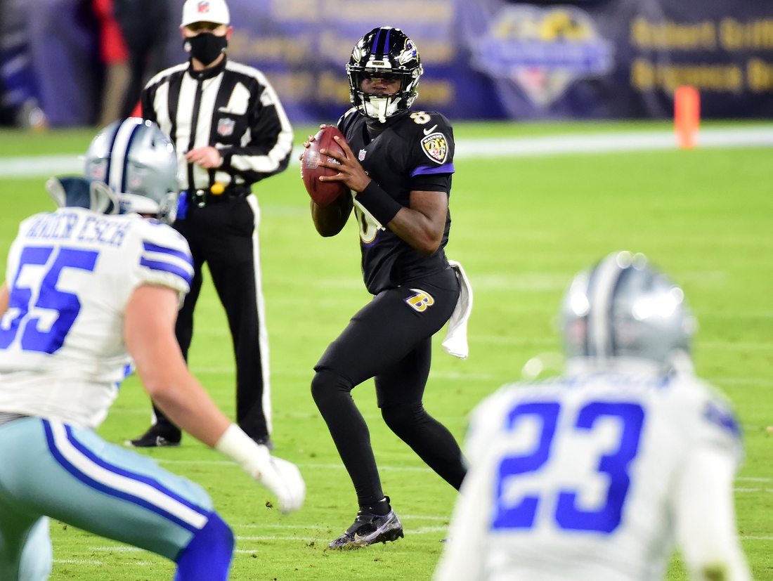 Dec 8, 2020; Baltimore, Maryland, USA; Baltimore Ravens quarterback Lamar Jackson (8) looks to throw a pass in the second quarter against the Dallas Cowboys at M&T Bank Stadium. Mandatory Credit: Evan Habeeb-USA TODAY Sports