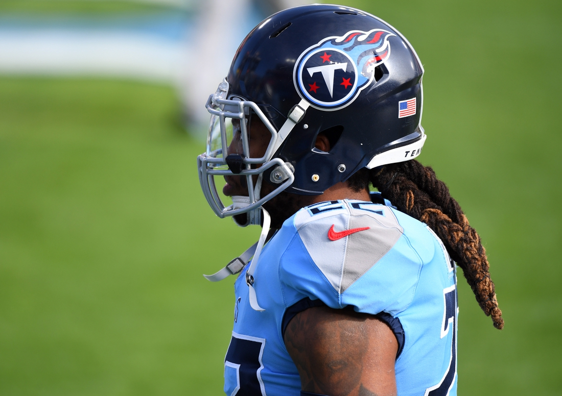 Dec 6, 2020; Nashville, Tennessee, USA; Tennessee Titans running back Derrick Henry (22) walks off the field after warmups before the game against the Cleveland Browns at Nissan Stadium. Mandatory Credit: Christopher Hanewinckel-USA TODAY Sports