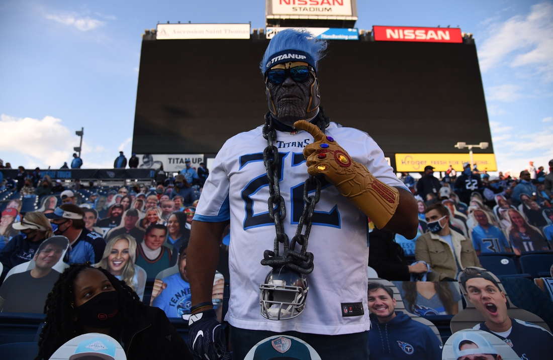 Dec 6, 2020; Nashville, Tennessee, USA; A Tennessee Titans fan during the game against the Cleveland Browns at Nissan Stadium. Mandatory Credit: Christopher Hanewinckel-USA TODAY Sports
