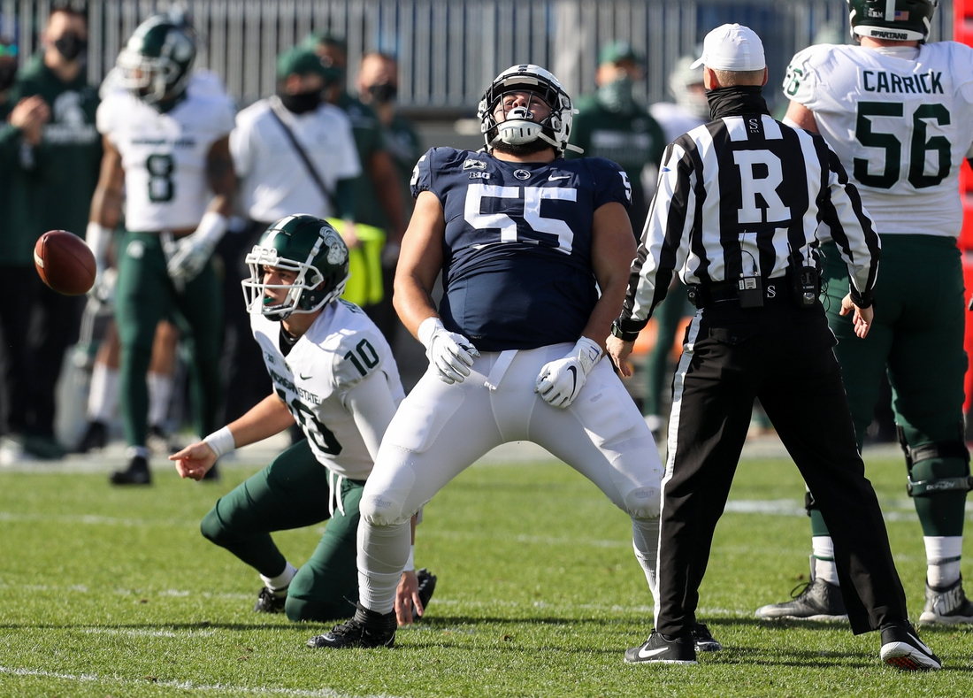 Dec 12, 2020; University Park, Pennsylvania, USA; Penn State Nittany Lions defensive tackle Antonio Shelton (55) reacts following a sack on Michigan State Spartans quarterback Payton Thorne (10) during the first quarter at Beaver Stadium. Mandatory Credit: Matthew OHaren-USA TODAY Sports