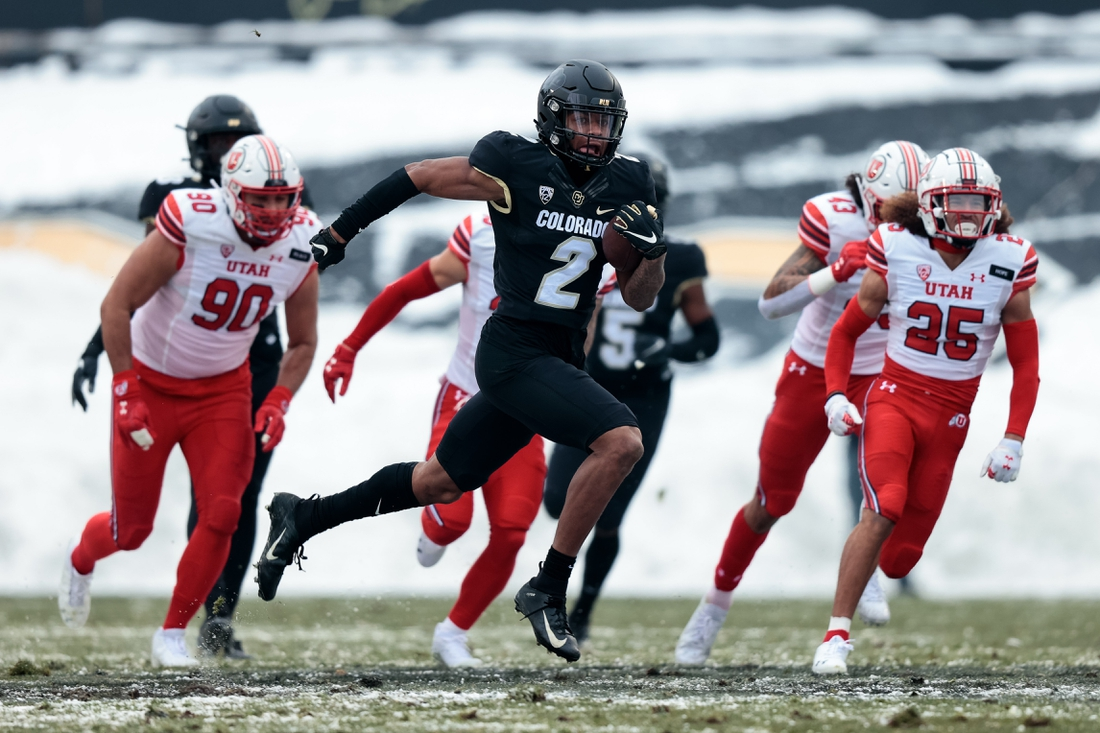 Dec 12, 2020; Boulder, Colorado, USA; Colorado Buffaloes wide receiver Brenden Rice (2) returns the ball for an 81 yard touchdown against Utah Utes defensive end Devin Kaufusi (90) and cornerback Kenzel Lawler (25) in the second quarter at Folsom Field. Mandatory Credit: Isaiah J. Downing-USA TODAY Sportsffd