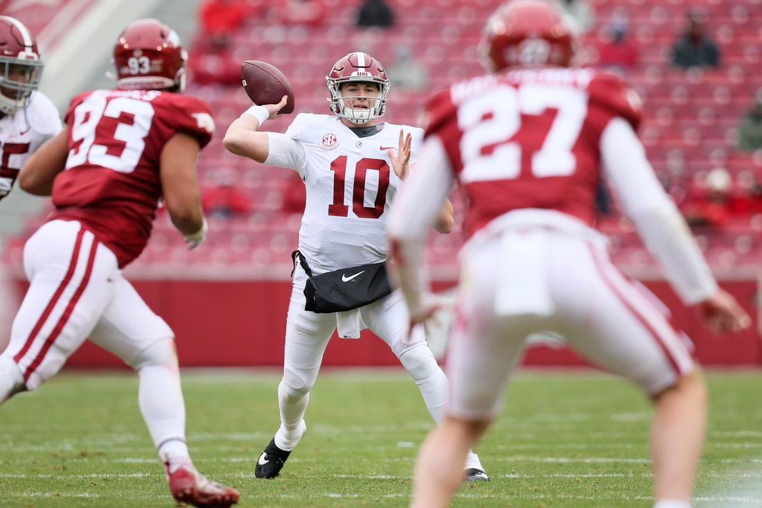 Dec 12, 2020; Fayetteville, Arkansas, USA;  Alabama Crimson Tide quarterback Mac Jones (10) throws a pass against the Arkansas Razorbacks in the second quarter at Donald W. Reynolds Razorback Stadium. Mandatory Credit: Nelson Chenault-USA TODAY Sports