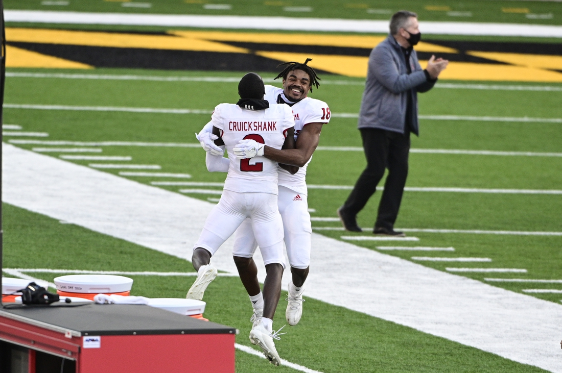 Dec 12, 2020; College Park, Maryland, USA; Rutgers Scarlet Knights defensive back Keenan Reid (18) and Rutgers Scarlet Knights wide receiver Aron Cruickshank (2) celebrate after defeatingMaryland Terrapins in overtime  at Capital One Field at Maryland Stadium. Mandatory Credit: Tommy Gilligan-USA TODAY Sports