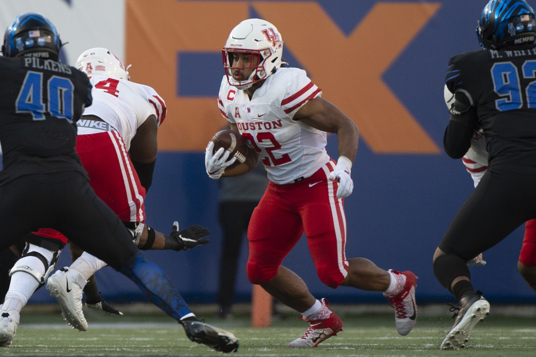 Dec 12, 2020; Memphis, Tennessee, USA; Houston Cougars running back Kyle Porter (22) carries the ball during the first half against the Memphis Tigers  at Liberty Bowl Memorial Stadium. Mandatory Credit: Justin Ford-USA TODAY Sports
