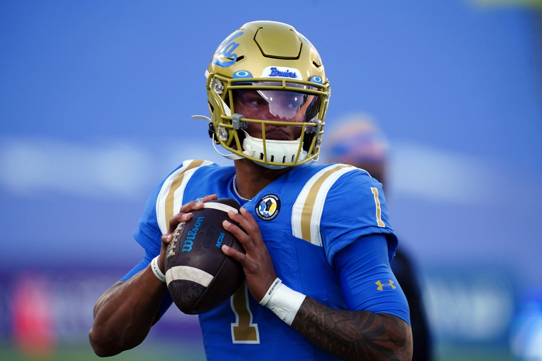 Dec 12, 2020; Pasadena, California, USA; UCLA Bruins quarterback Dorian Thompson-Robinson (1) throws the ball before the game against the Southern California Trojans at Rose Bowl. Mandatory Credit: Kirby Lee-USA TODAY Sports