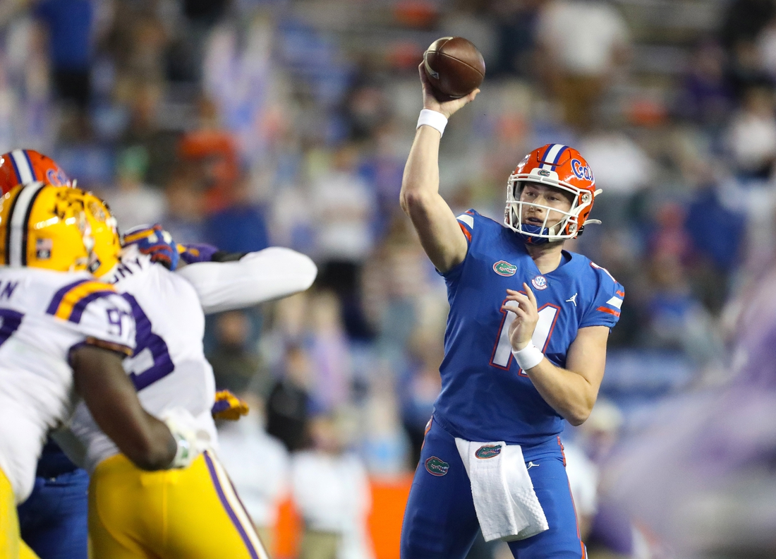 Dec 12, 2020; Gainesville, FL, USA; Florida Gators quarterbacks Kyle Trask (11) throws the ball for a first down in the first half in the game against the LSU Tigers at Ben Hill Griffin Stadium in Gainesville, Fla. Dec. 12, 2020.  Mandatory Credit: Brad McClenny-USA TODAY NETWORK