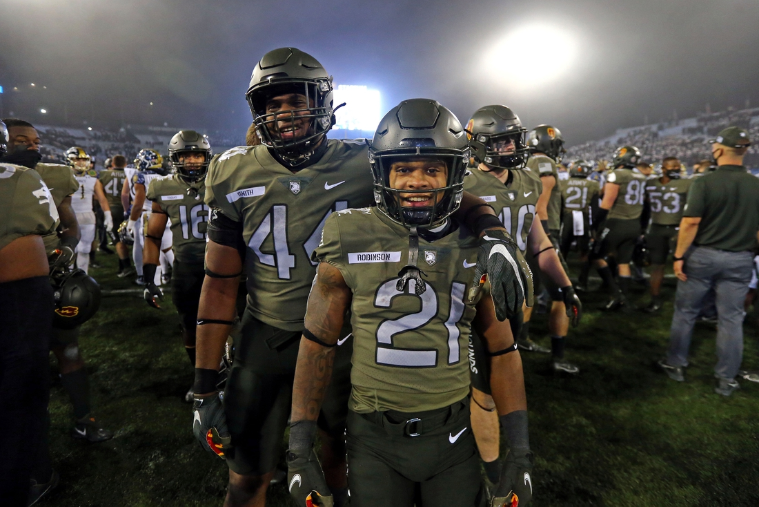 Dec 12, 2020; West Point, New York, USA; Army Black Knights running back Tyrell Robinson (21) celebrates a 15-0 win over Navy in the Army-Navy game at Michie Stadium. Mandatory Credit: Danny Wild-USA TODAY Sports