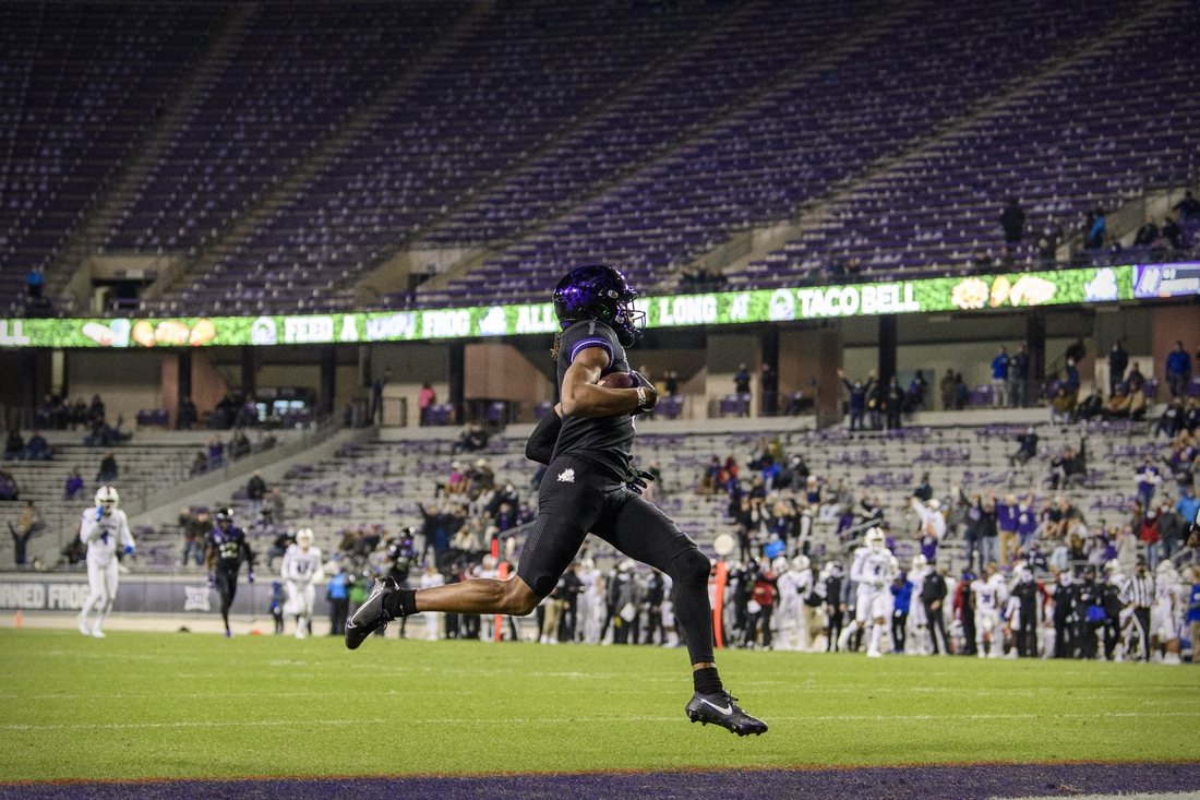 Dec 12, 2020; Fort Worth, Texas, USA; TCU Horned Frogs wide receiver Quentin Johnston (1) catches a pass for a touchdown against the Louisiana Tech Bulldogs during the first half at Amon G. Carter Stadium. Mandatory Credit: Jerome Miron-USA TODAY Sports