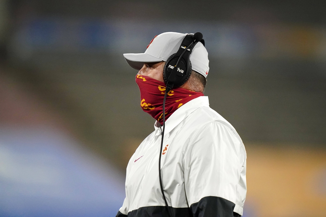 Dec 12, 2020; Pasadena, California, USA; Southern California Trojans head coach Clay Helton watches from the sidelines wearing a face mask in the first half against the UCLA Bruins at Rose Bowl. Mandatory Credit: Kirby Lee-USA TODAY Sports