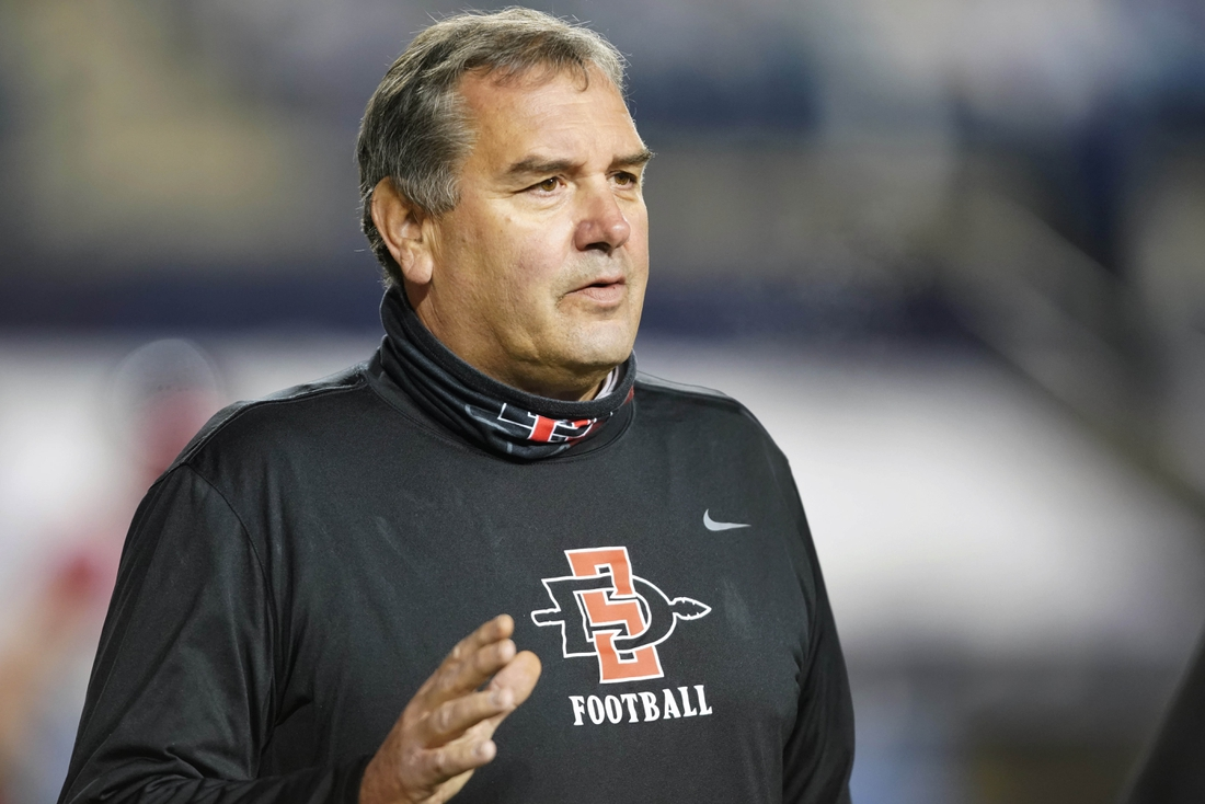 Dec 12, 2020; Provo, UT, USA; San Diego State head coach Brady Hoke talks to other coaches before an NCAA college football game against BYU Saturday, Dec. 12, 2020, in Provo, Utah.  Mandatory Credit: George Frey/Pool Photo-USA TODAY Sports
