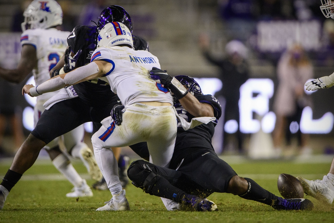 Dec 12, 2020; Fort Worth, Texas, USA; Louisiana Tech Bulldogs quarterback Luke Anthony (9) suffers a leg injury while being sacked by TCU Horned Frogs defensive end Dylan Horton (98) during the second half at Amon G. Carter Stadium. Mandatory Credit: Jerome Miron-USA TODAY Sports