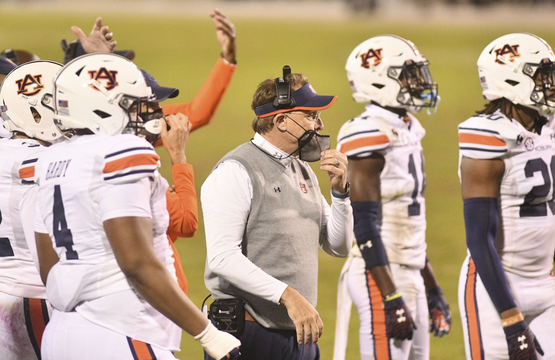 Dec 12, 2020; Starkville, Mississippi, USA; Auburn Tigers head coach Gus Malzahn walks onto the field during a timeout during the fourth quarter of the game against the Mississippi State Bulldogs at Davis Wade Stadium at Scott Field. Mandatory Credit: Matt Bush-USA TODAY Sports