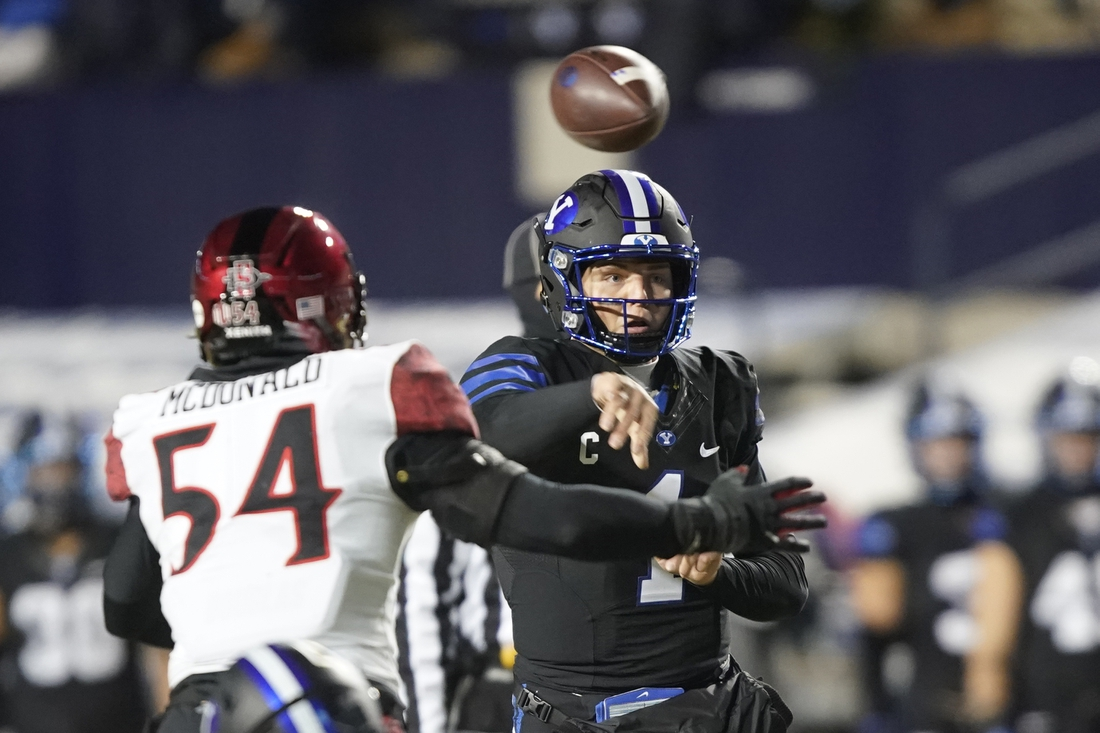 Dec 12, 2020; Provo, UT, USA; BYU quarterback Zach Wilson passes the ball as San Diego State linebacker Caden McDonald (54) defends in the first half, of an NCAA college football game Saturday, Dec. 12, 2020, in Provo, Utah.  Mandatory Credit: George Frey/Pool Photo-USA TODAY Sports