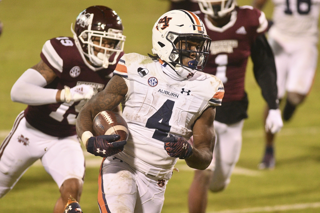 Dec 12, 2020; Starkville, Mississippi, USA; Auburn Tigers running back Tank Bigsby (4) runs the ball against the Mississippi State Bulldogs during the fourth quarter at Davis Wade Stadium at Scott Field. Mandatory Credit: Matt Bush-USA TODAY Sports