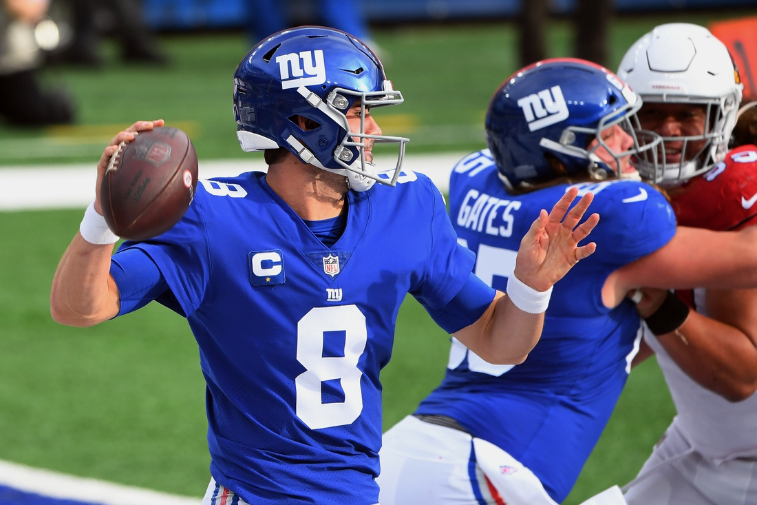Dec 13, 2020; East Rutherford, New Jersey, USA; New York Giants quarterback Daniel Jones (8) drops back to pass against the Arizona Cardinals during the first half at MetLife Stadium. Mandatory Credit: Robert Deutsch-USA TODAY Sports