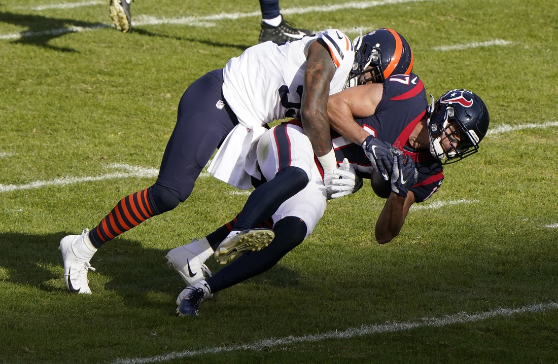 Dec 13, 2020; Chicago, Illinois, USA; Houston Texans wide receiver Chad Hansen (17) makes a catch against Chicago Bears inside linebacker Danny Trevathan (59) during the second quarter at Soldier Field. Mandatory Credit: Mike Dinovo-USA TODAY Sports