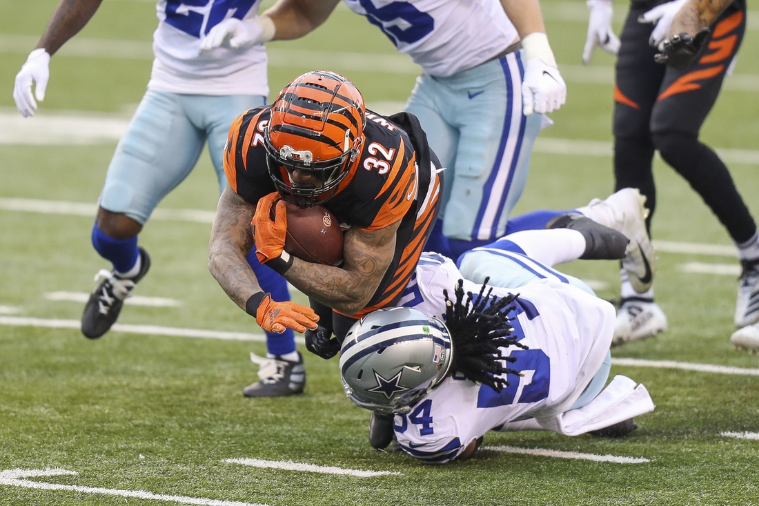 Dec 13, 2020; Cincinnati, Ohio, USA; Dallas Cowboys linebacker Jaylon Smith (54) tackles Cincinnati Bengals running back Trayveon Williams (32) in the first half at Paul Brown Stadium. Mandatory Credit: Katie Stratman-USA TODAY Sports