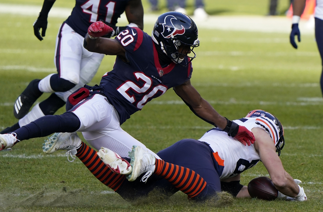 Dec 13, 2020; Chicago, Illinois, USA; Chicago Bears tight end Cole Kmet (85) attempts to make a catch against Houston Texans strong safety Justin Reid (20) during the third quarter at Soldier Field. Mandatory Credit: Mike Dinovo-USA TODAY Sports