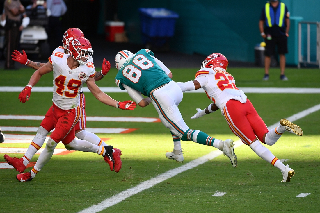Dec 13, 2020; Miami Gardens, Florida, USA; Miami Dolphins tight end Mike Gesicki (88) scores a touchdown after a catch over Kansas City Chiefs free safety Juan Thornhill (22) during the second half at Hard Rock Stadium. Mandatory Credit: Jasen Vinlove-USA TODAY Sports