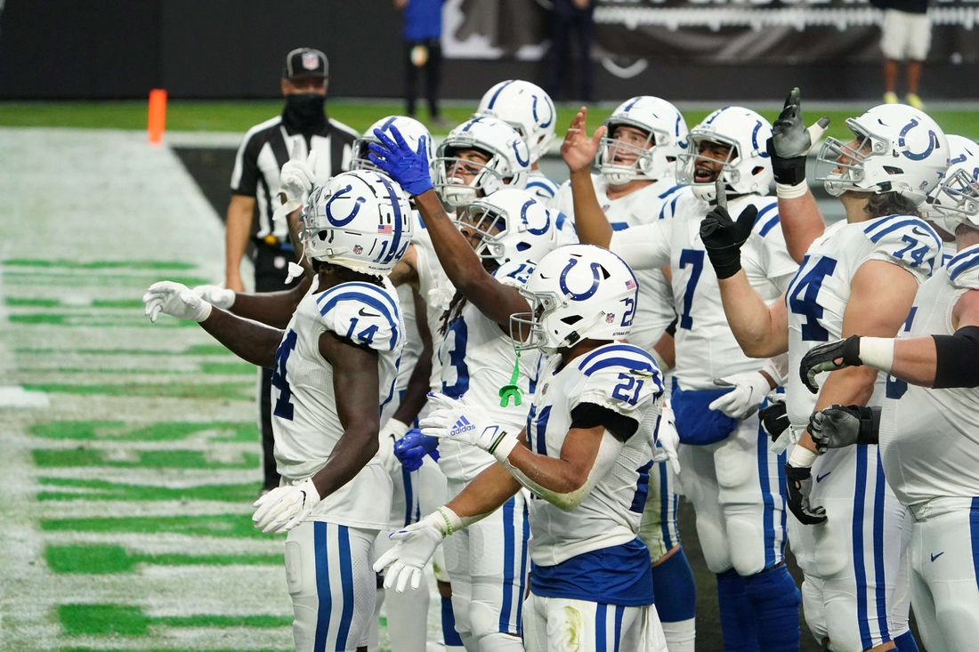 Dec 13, 2020; Paradise, Nevada, USA; Indianapolis Colts wide receiver T.Y. Hilton (13) celebrates with teammates after scoring a touchdown in the first quarter against the Las Vegas Raiders at Allegiant Stadium. Mandatory Credit: Kirby Lee-USA TODAY Sports