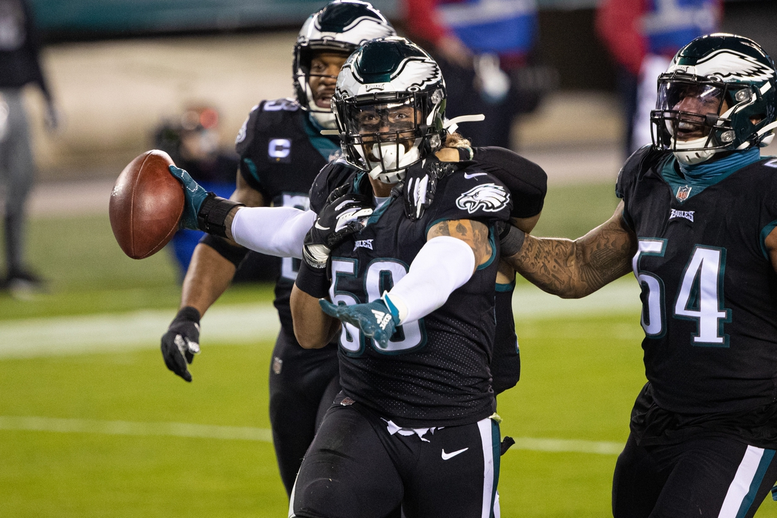 Dec 13, 2020; Philadelphia, Pennsylvania, USA; Philadelphia Eagles middle linebacker Duke Riley (50) celebrates with linebacker Alex Singleton (49) and cornerback Avonte Maddox (29) after his interception against the New Orleans Saints during the second quarter at Lincoln Financial Field. Mandatory Credit: Bill Streicher-USA TODAY Sports