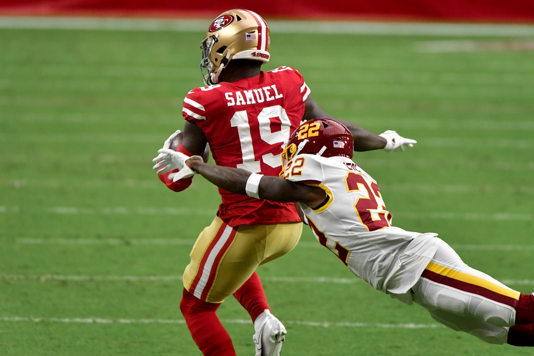 Dec 13, 2020; Glendale, Arizona, USA;  San Francisco 49ers wide receiver Deebo Samuel (19) runs the ball and is tackled by Washington Football Team free safety Deshazor Everett (22) during the first half at State Farm Stadium. Mandatory Credit: Matt Kartozian-USA TODAY Sports