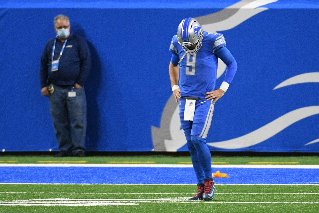 Dec 13, 2020; Detroit, Michigan, USA; Detroit Lions quarterback Matthew Stafford (9) reacts after an injury during the fourth quarter against the Green Bay Packers at Ford Field. Mandatory Credit: Tim Fuller-USA TODAY Sports