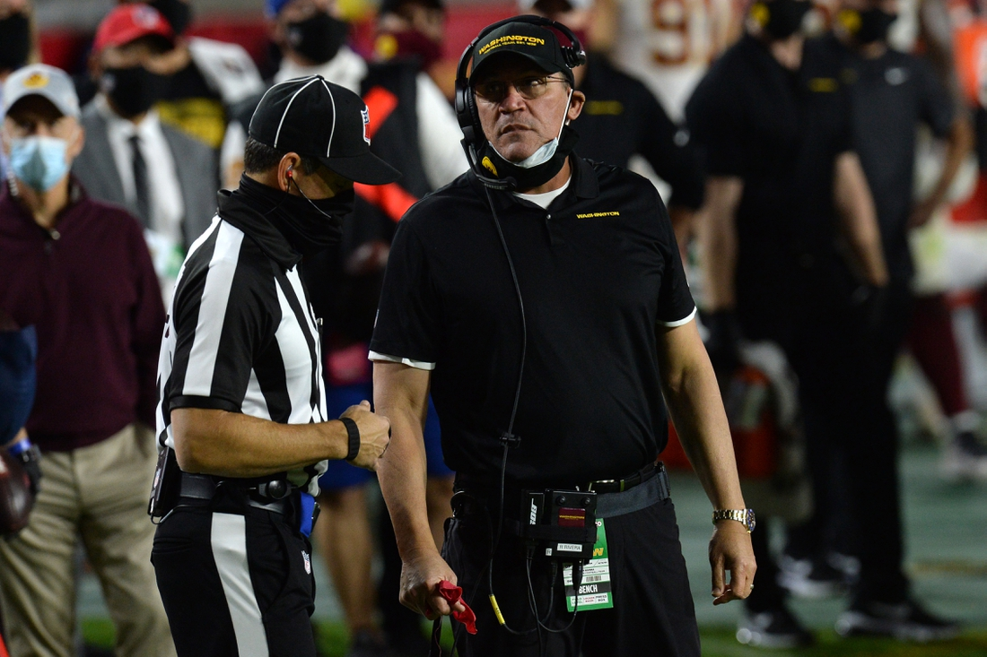 Dec 13, 2020; Glendale, Arizona, USA; Washington Football Team head coach Ron Rivera talks with an official against the San Francisco 49ers during the second half at State Farm Stadium. Mandatory Credit: Joe Camporeale-USA TODAY Sports