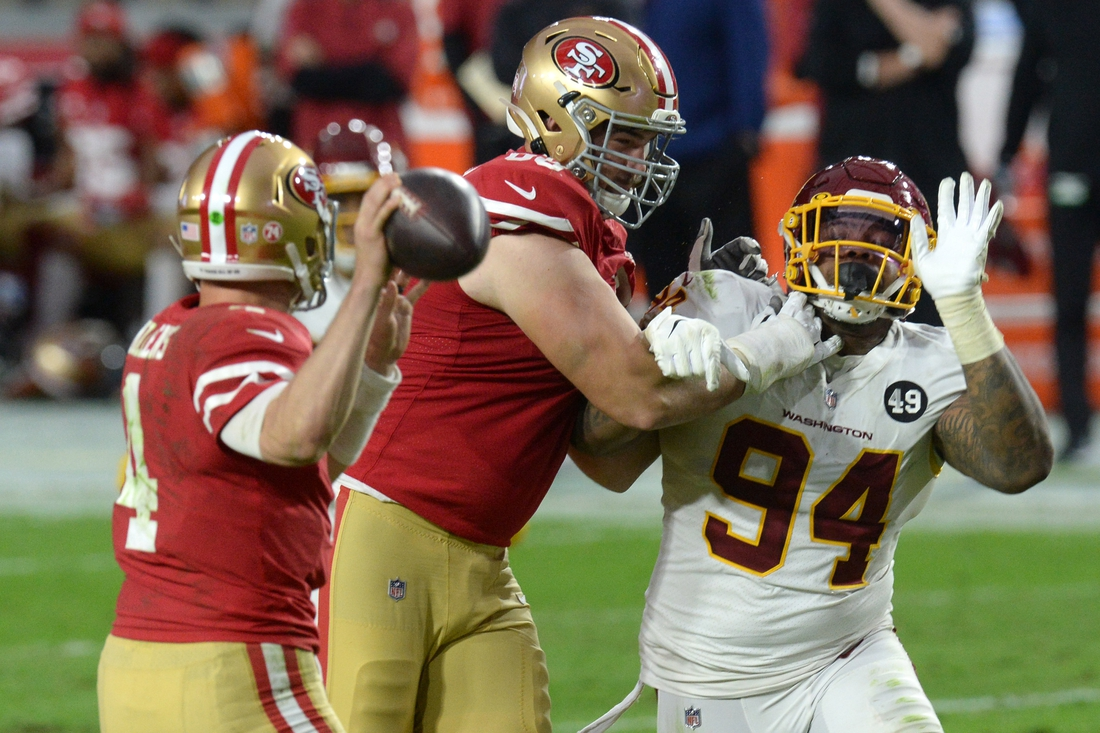 Dec 13, 2020; Glendale, Arizona, USA; Washington Football Team defensive tackle Daron Payne (94) rushes San Francisco 49ers quarterback Nick Mullens (4) during the second half at State Farm Stadium. Mandatory Credit: Joe Camporeale-USA TODAY Sports