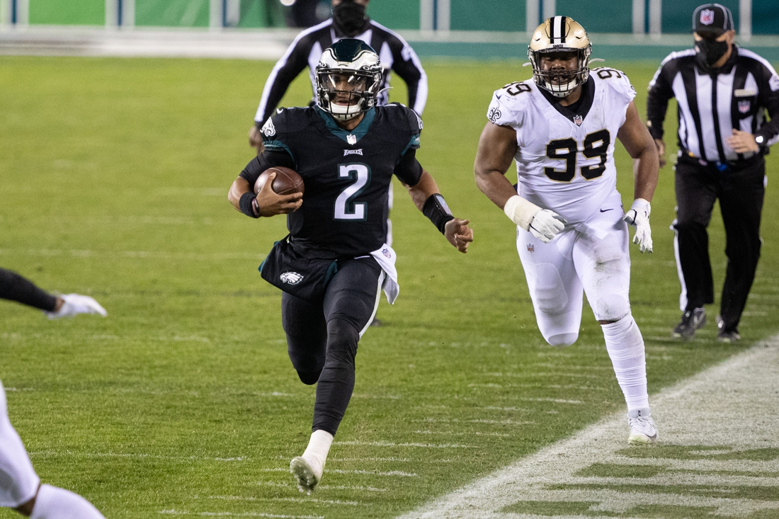 Dec 13, 2020; Philadelphia, Pennsylvania, USA; Philadelphia Eagles quarterback Jalen Hurts (2) runs with the ball past New Orleans Saints defensive tackle Shy Tuttle (99) during the second quarter at Lincoln Financial Field. Mandatory Credit: Bill Streicher-USA TODAY Sports