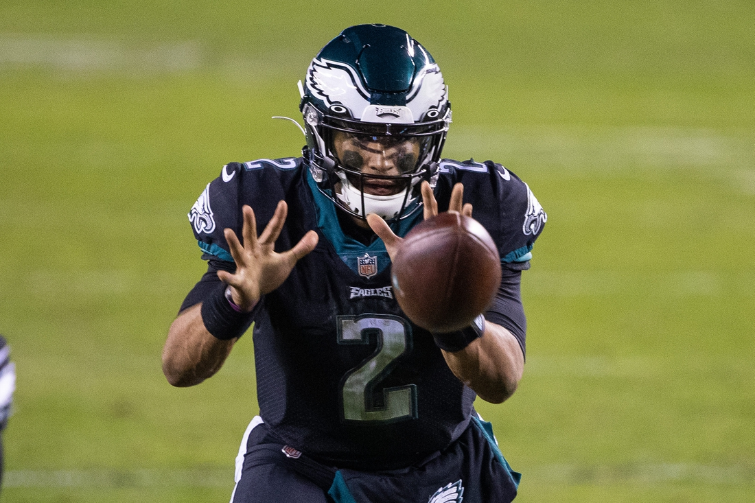 Dec 13, 2020; Philadelphia, Pennsylvania, USA; Philadelphia Eagles quarterback Jalen Hurts (2) receives a snapped ball against the New Orleans Saints during the fourth quarter at Lincoln Financial Field. Mandatory Credit: Bill Streicher-USA TODAY Sports