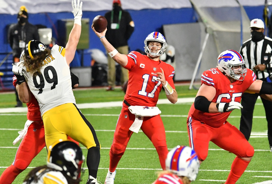 Dec 13, 2020; Orchard Park, New York, USA; Pittsburgh Steelers wide receiver Deon Cain (17) throws a pass as Pittsburgh Steelers defensive tackle Henry Mondeaux (99) rushes in the second quarter at Bills Stadium. Mandatory Credit: Mark Konezny-USA TODAY Sports