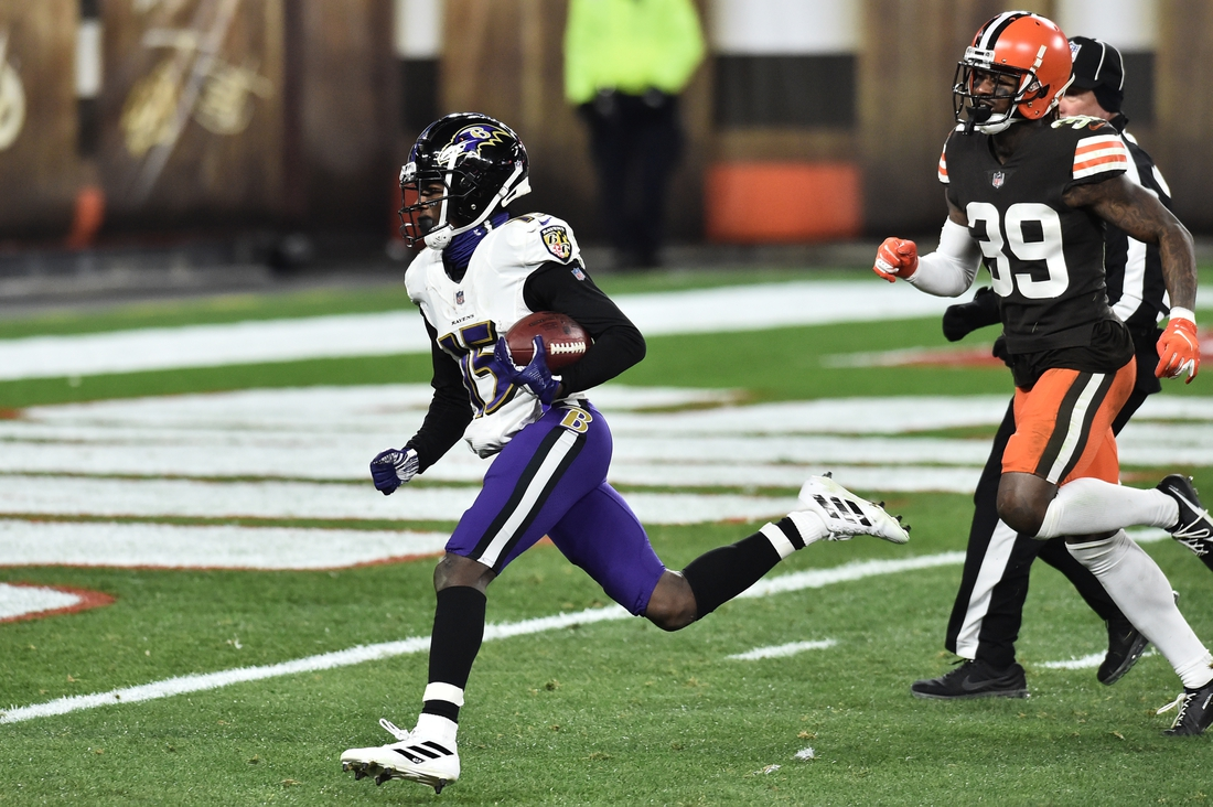 Dec 14, 2020; Cleveland, Ohio, USA; Baltimore Ravens wide receiver Marquise Brown (15) scores a touchdown as Cleveland Browns cornerback Terrance Mitchell (39) defends during the second half at FirstEnergy Stadium. Mandatory Credit: Ken Blaze-USA TODAY Sports
