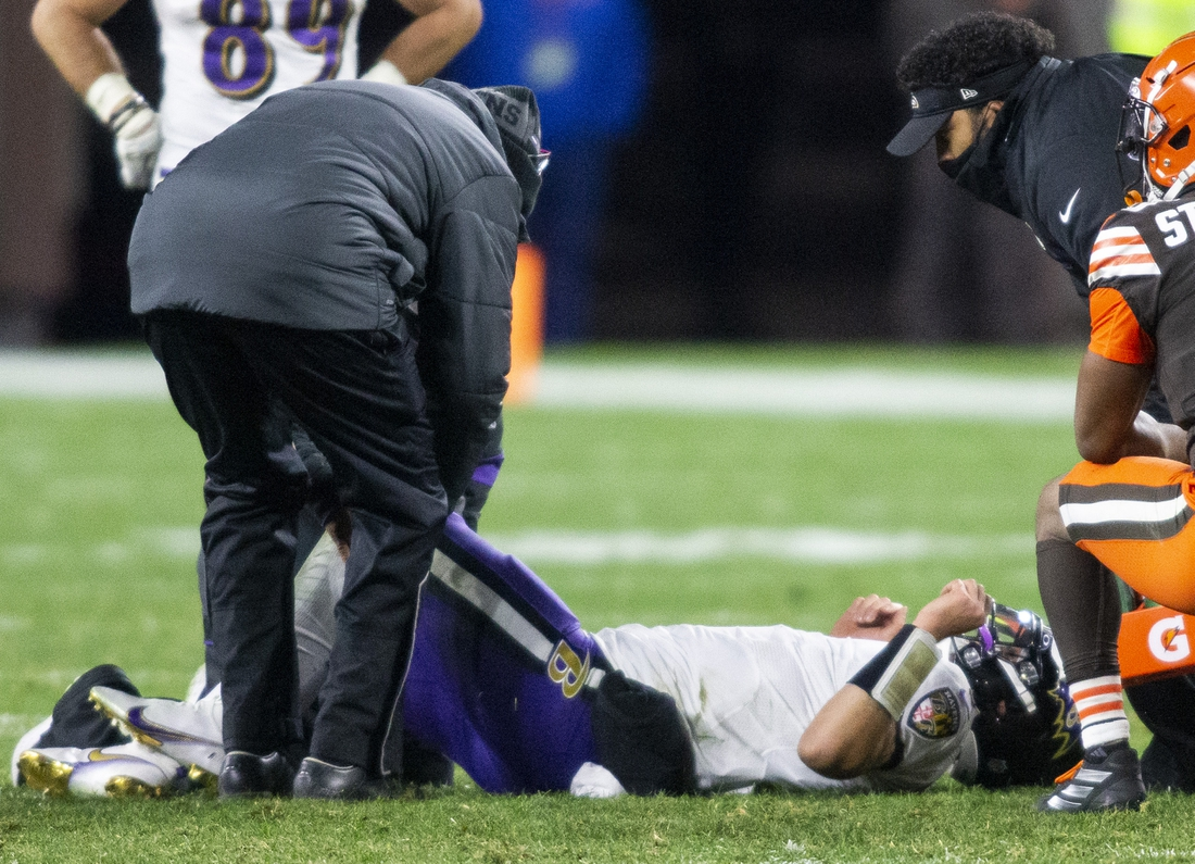Dec 14, 2020; Cleveland, Ohio, USA; Baltimore Ravens quarterback Trace McSorley (7) lays on the ground from an injury during the fourth quarter against the Cleveland Browns at FirstEnergy Stadium. Mandatory Credit: Scott Galvin-USA TODAY Sports