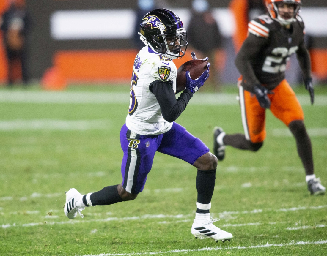 Dec 14, 2020; Cleveland, Ohio, USA; Baltimore Ravens wide receiver Marquise Brown (15) runs the ball for a touchdown following his reception against the Cleveland Browns during the fourth quarter at FirstEnergy Stadium. Mandatory Credit: Scott Galvin-USA TODAY Sports