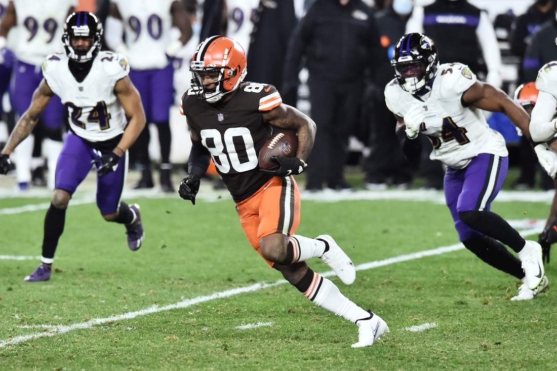 Dec 14, 2020; Cleveland, Ohio, USA; Cleveland Browns wide receiver Jarvis Landry (80) runs with the ball after a catch as Baltimore Ravens cornerback Marcus Peters (24) and linebacker Tyus Bowser (54) defend during the second half at FirstEnergy Stadium. Mandatory Credit: Ken Blaze-USA TODAY Sports