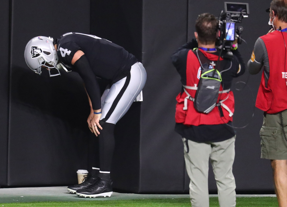 Dec 17, 2020; Paradise, Nevada, USA;Las Vegas Raiders quarterback Derek Carr (4) reacts after suffering an apparent injury against the Los Angeles Chargers during the first half at Allegiant Stadium. Mandatory Credit: Mark J. Rebilas-USA TODAY Sports