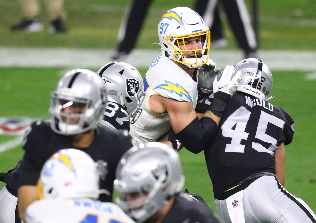 Dec 17, 2020; Paradise, Nevada, USA; Los Angeles Chargers defensive end Joey Bosa (97) moves against Las Vegas Raiders fullback Alec Ingold (45) during the second half at Allegiant Stadium. Mandatory Credit: Mark J. Rebilas-USA TODAY Sports