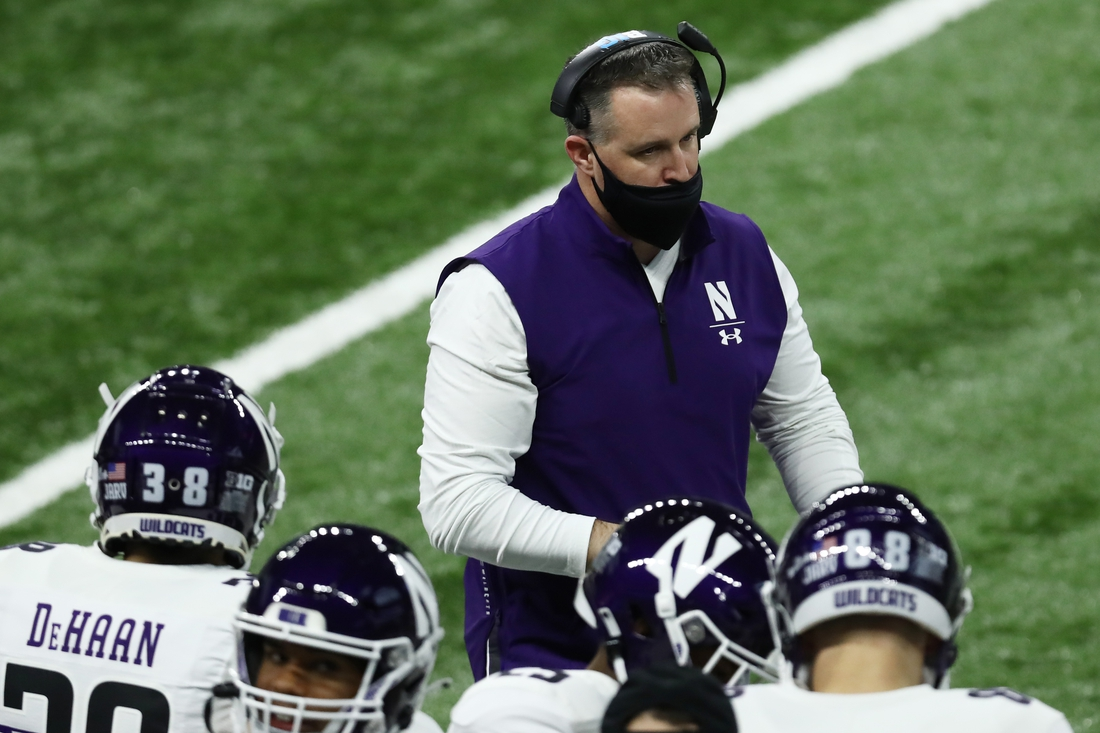 Dec 19, 2020; Indianapolis, Indiana, USA; Northwestern Wildcats head coach Pat Fitzgerald looks on during the first half against the Ohio State Buckeyes at Lucas Oil Stadium. Mandatory Credit: Aaron Doster-USA TODAY Sports
