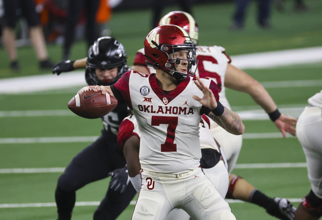 Dec 19, 2020; Arlington, Texas, USA;  Oklahoma Sooners quarterback Spencer Rattler (7) throws  during the first half against the Iowa State Cyclones at AT&T Stadium. Mandatory Credit: Kevin Jairaj-USA TODAY Sports