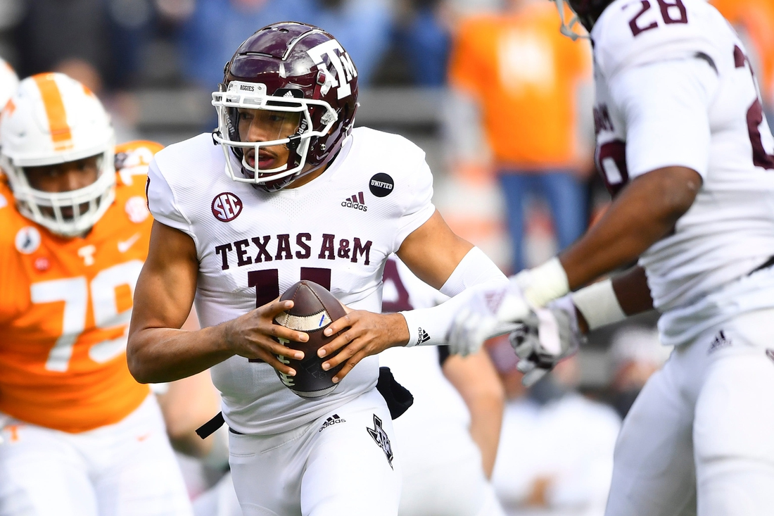 Dec 19, 2020; Knoxville, TN, USA;  Texas A&M quarterback Kellen Mond (11) scrambles with the ball during a game between Tennessee and Texas A&M in Neyland Stadium in Knoxville, Saturday, Dec. 19, 2020. Mandatory Credit: Brianna Paciorka-USA TODAY NETWORK