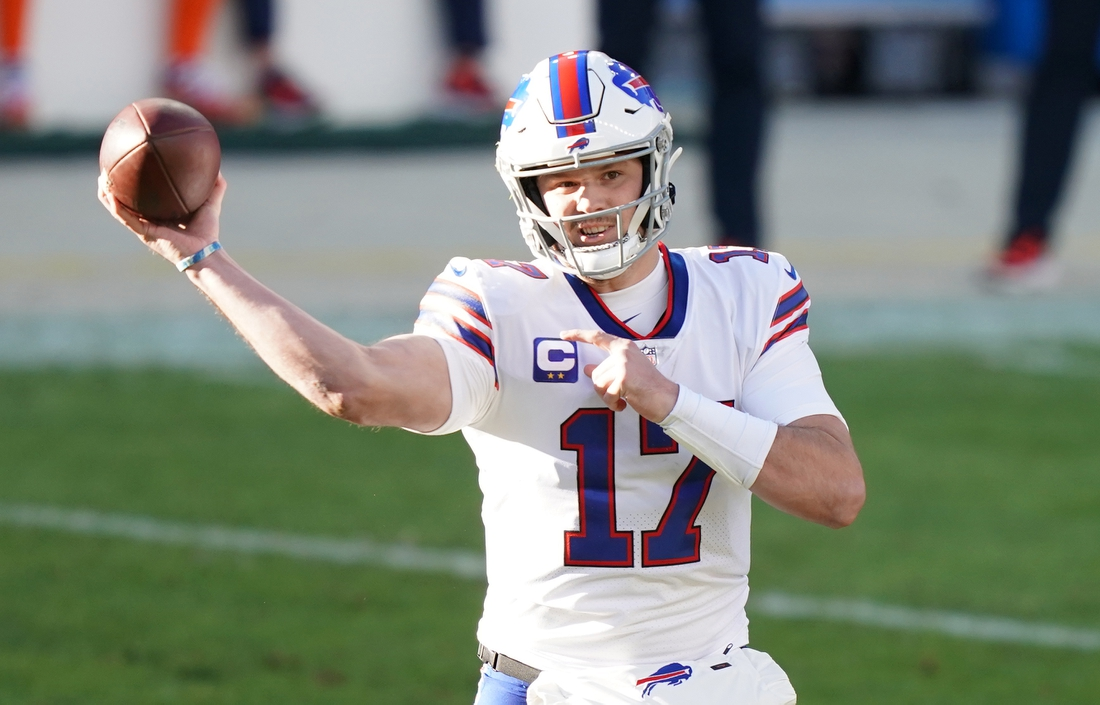 Dec 19, 2020; Denver, Colorado, USA; Buffalo Bills quarterback Josh Allen (17) throws against the Denver Broncos during the first quarter at Empower Field at Mile High. Mandatory Credit: Troy Babbitt-USA TODAY Sports