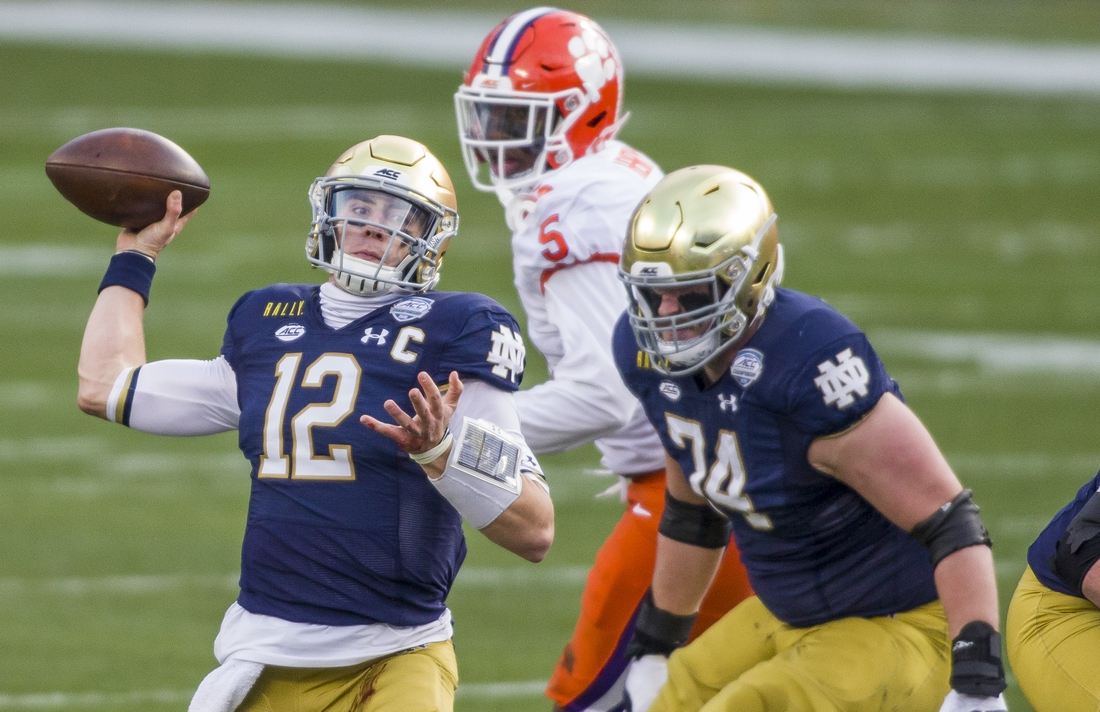 Dec 19, 2020; Charlotte, NC, USA;  Notre Dame s Ian Book (12) throws downfield during the ACC Championship football game on Saturday, Dec. 19, 2020, inside Bank of America Stadium in Charlotte, NC. Mandatory Credit: Robert Franklin/South Bend Tribune via USA TODAY NETWORK