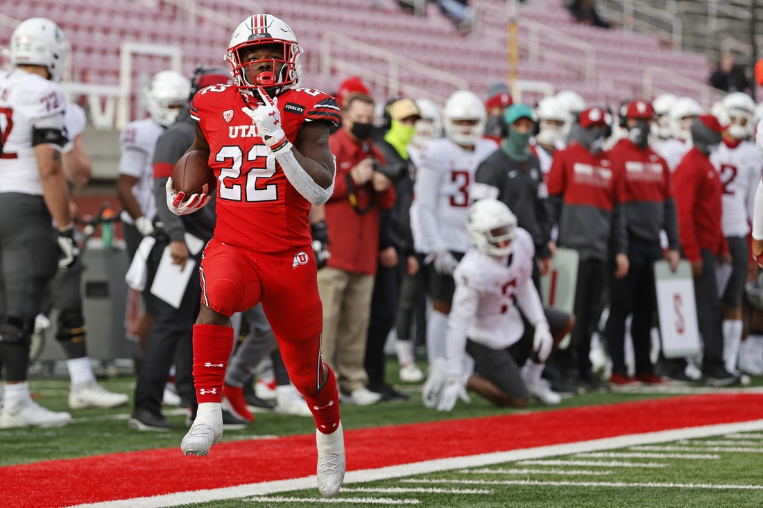 Dec 19, 2020; Salt Lake City, Utah, USA; Utah Utes running back Ty Jordan (22) runs in for a touchdown in the fourth quarter against the Washington State Cougars at Rice-Eccles Stadium. Mandatory Credit: Jeffrey Swinger-USA TODAY Sports