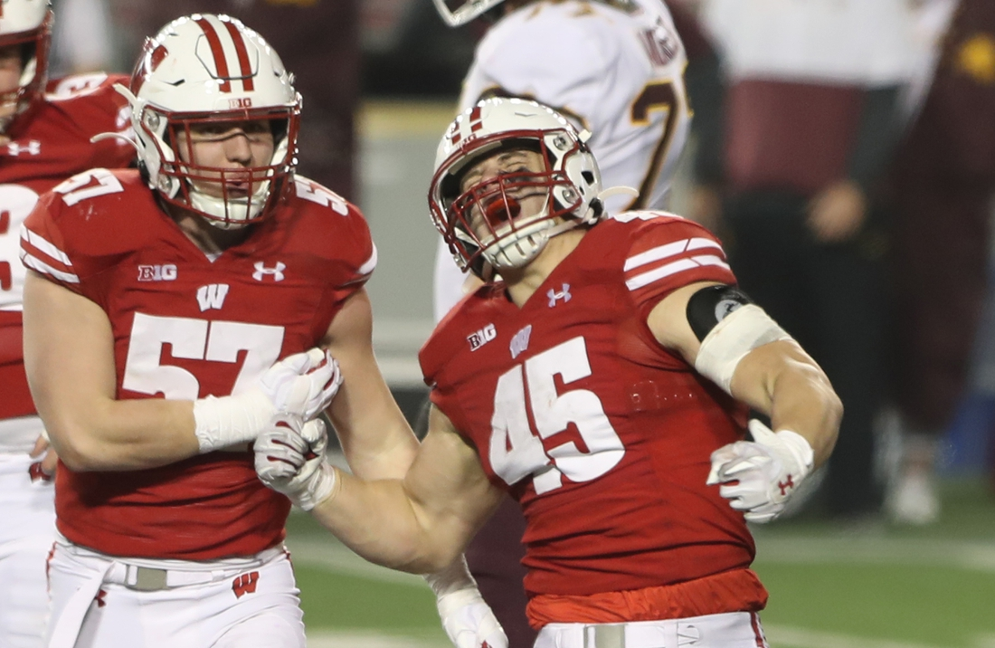 Dec 19, 2020; Madison, Wisconsin, USA; Wisconsin Badgers linebacker Leo Chenal (45) celebrates his third down tackle that stopped a Minnesota Golden Gophers advance during the second half at Camp Randall Stadium. Mandatory Credit: Mary Langenfeld-USA TODAY Sports