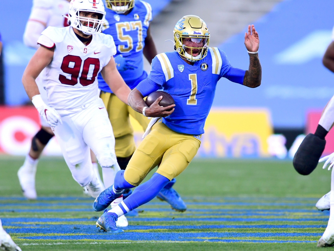 Dec 19, 2020; Pasadena, California, USA;  UCLA Bruins quarterback Dorian Thompson-Robinson (1) scrambles for yardage in the first half of the game against the Stanford Cardinal at the Rose Bowl. Mandatory Credit: Jayne Kamin-Oncea-USA TODAY Sports