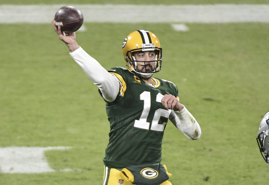Dec 19, 2020; Green Bay, Wisconsin, USA; Green Bay Packers quarterback Aaron Rodgers (12) throws a pass in the second quarter during the game against the Carolina Panthers at Lambeau Field. Mandatory Credit: Benny Sieu-USA TODAY Sports