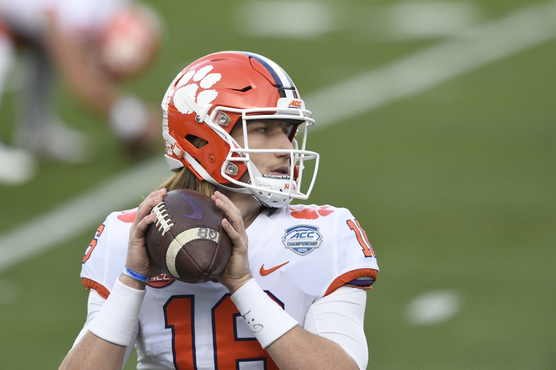 Dec 19, 2020; Charlotte, NC, USA; Clemson Tigers quarterback Trevor Lawrence (16) warms up before the game at Bank of America Stadium. Mandatory Credit: Bob Donnan-USA TODAY Sports