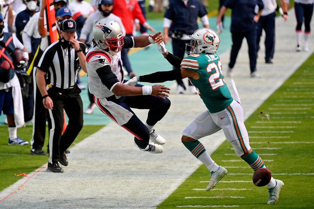 Dec 20, 2020; Miami Gardens, Florida, USA; Miami Dolphins free safety Brandon Jones (29) forces New England Patriots quarterback Cam Newton (1) to fumble the ball during the first half at Hard Rock Stadium. Mandatory Credit: Jasen Vinlove-USA TODAY Sports