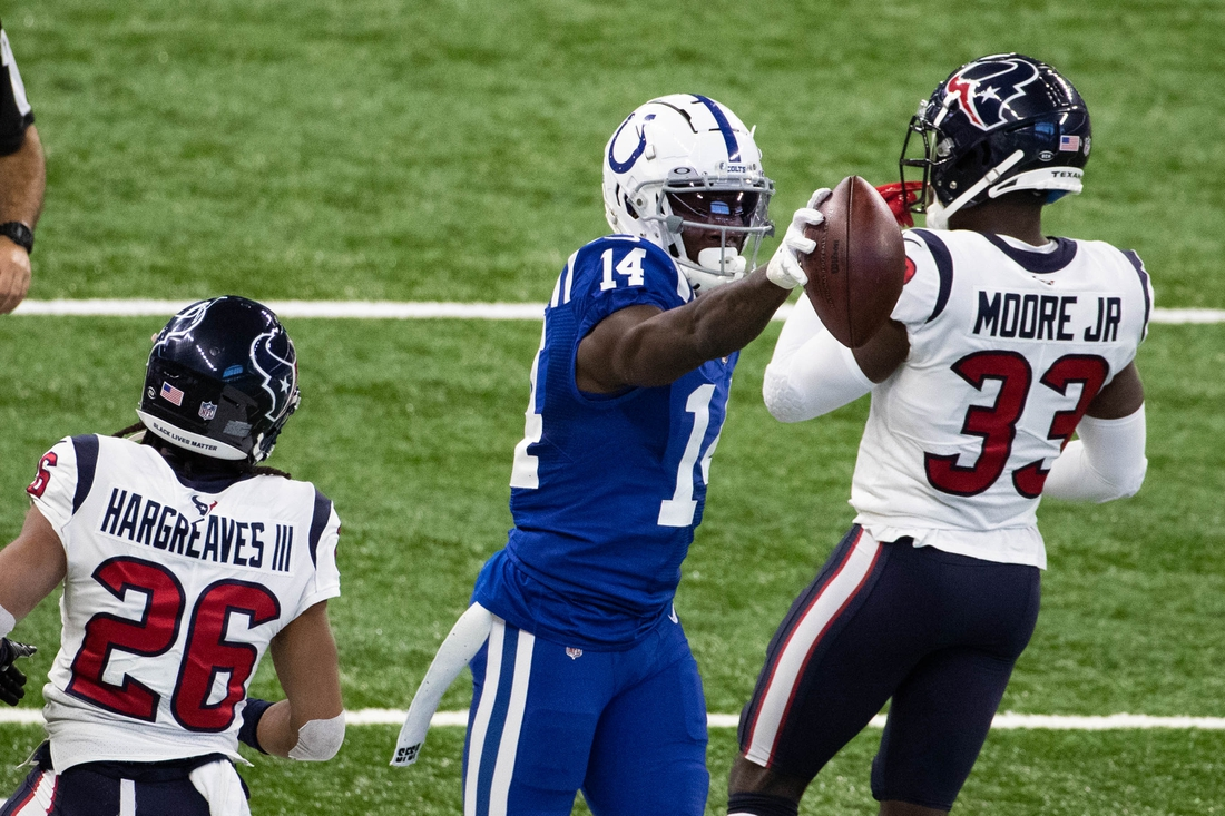 Dec 20, 2020; Indianapolis, Indiana, USA; Indianapolis Colts wide receiver Zach Pascal (14) signals first down after a catch against the Houston Texans in the first half at Lucas Oil Stadium. Mandatory Credit: Trevor Ruszkowski-USA TODAY Sports